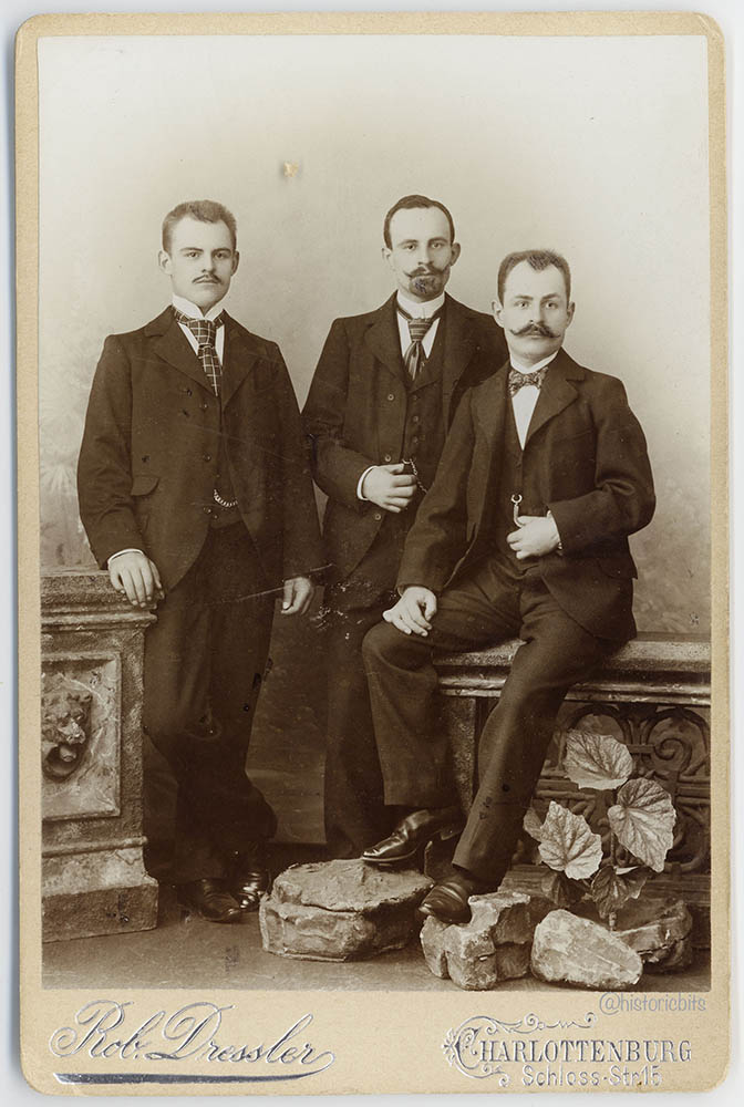 3 men in photostudio,Germany,1890