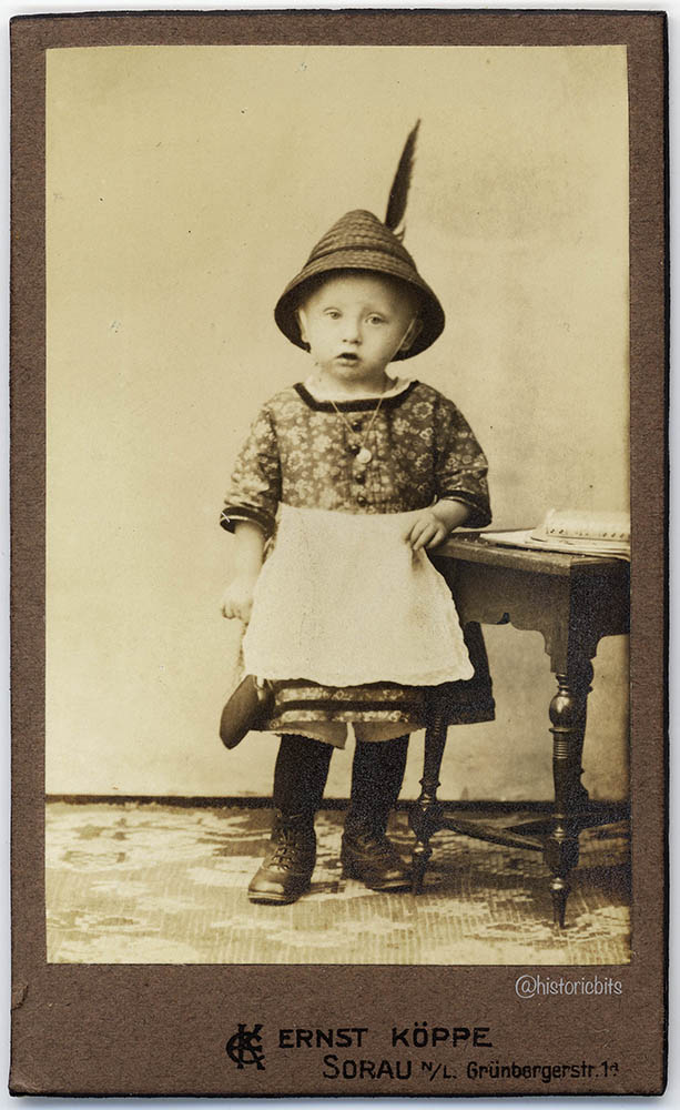 Child in traditional garb,c.1880
