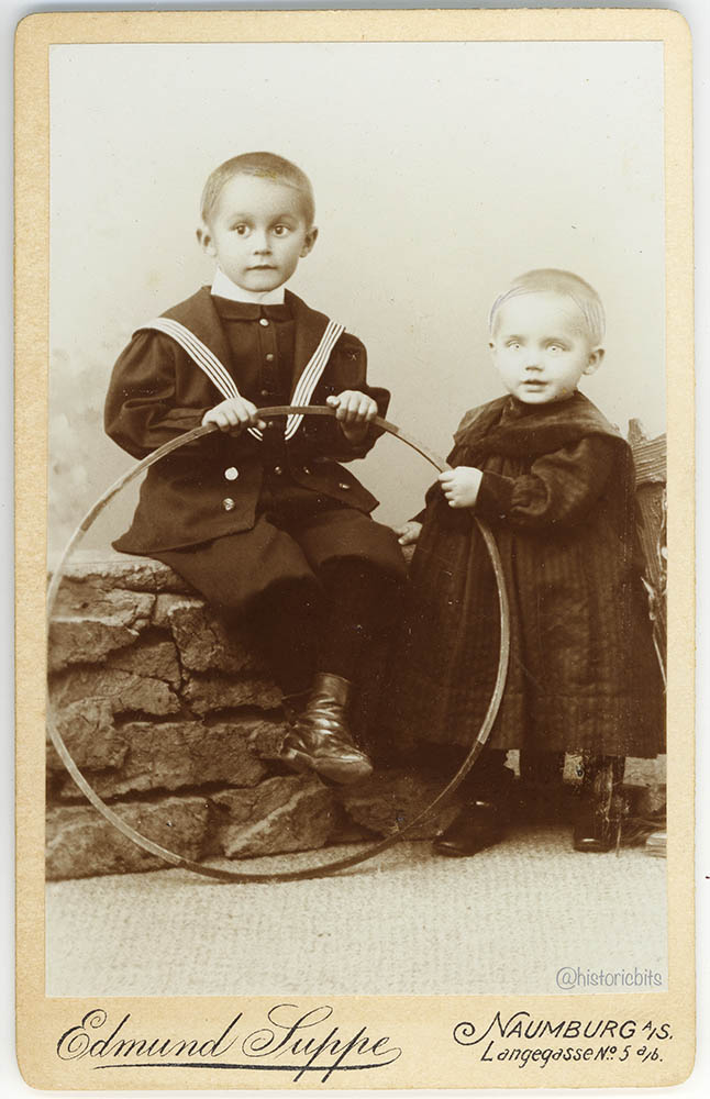 Children with trundling hoop, German,c.1890