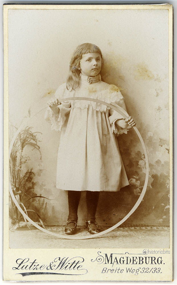 Child with trundling hoop, German,1895