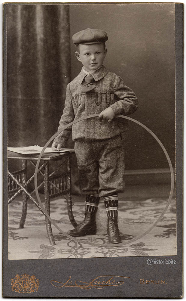 Child with trundling hoop, Germany,c.1900