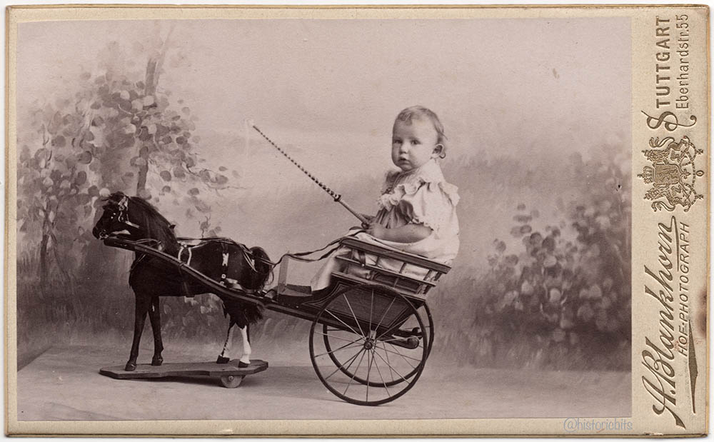 Girl in a toy carriage,germany c1880
